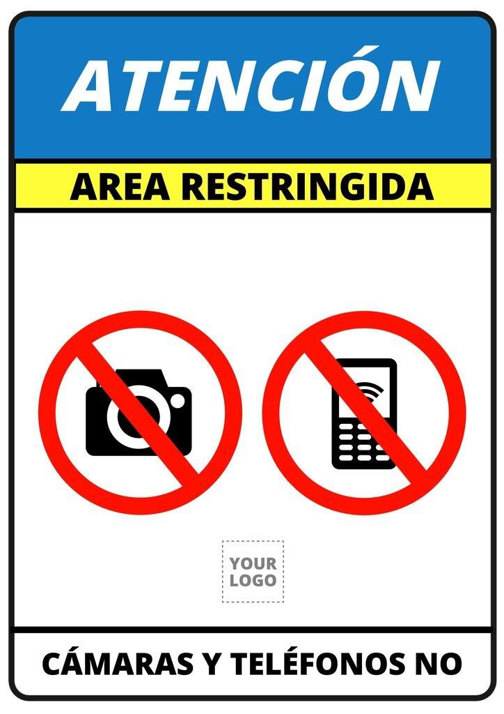 Cartel area restringida prohibido usar el móvil o hacer fotos
